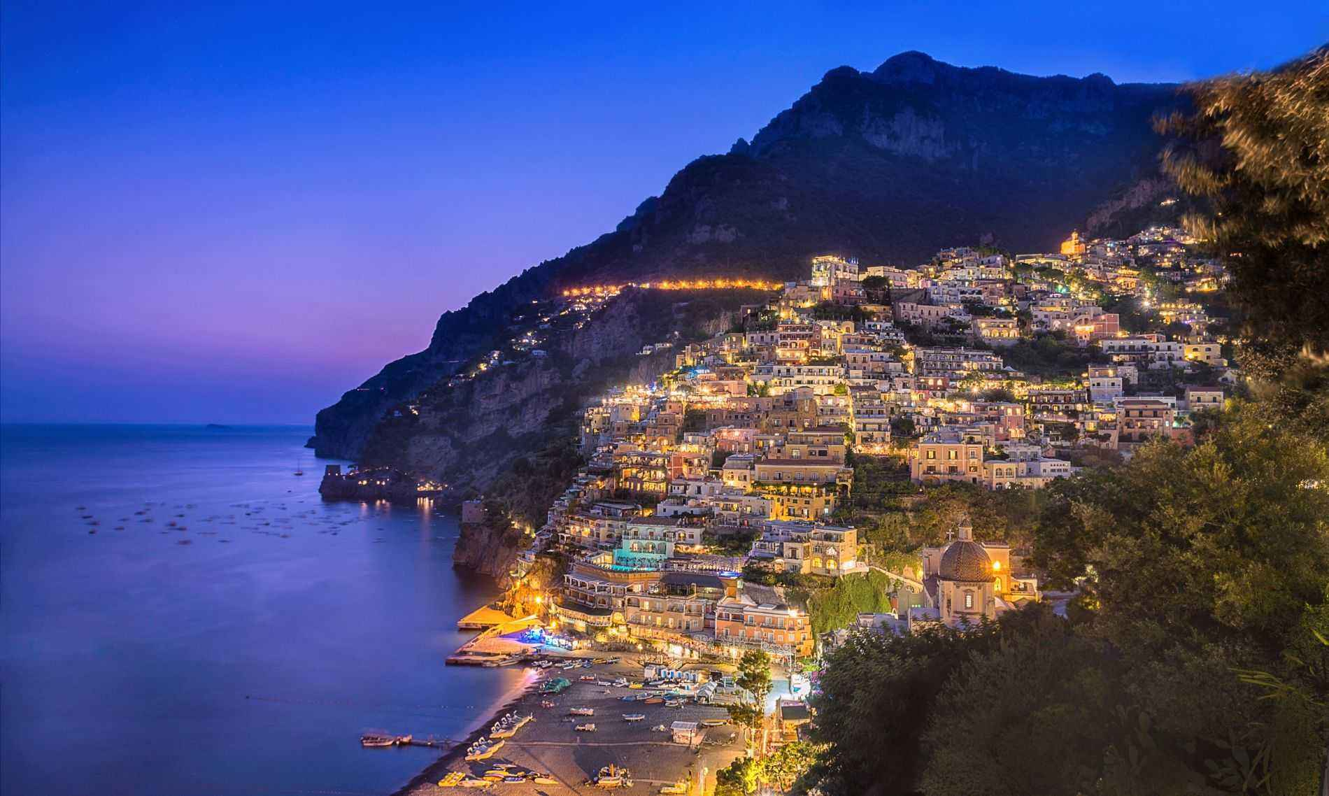Illuminated view of Positano cradled by the sea, Italy
