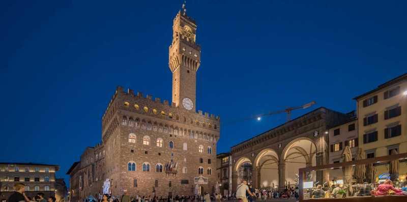 Evening view of Piazza della Signoria and Palazzo Vecchio Tower in Florence