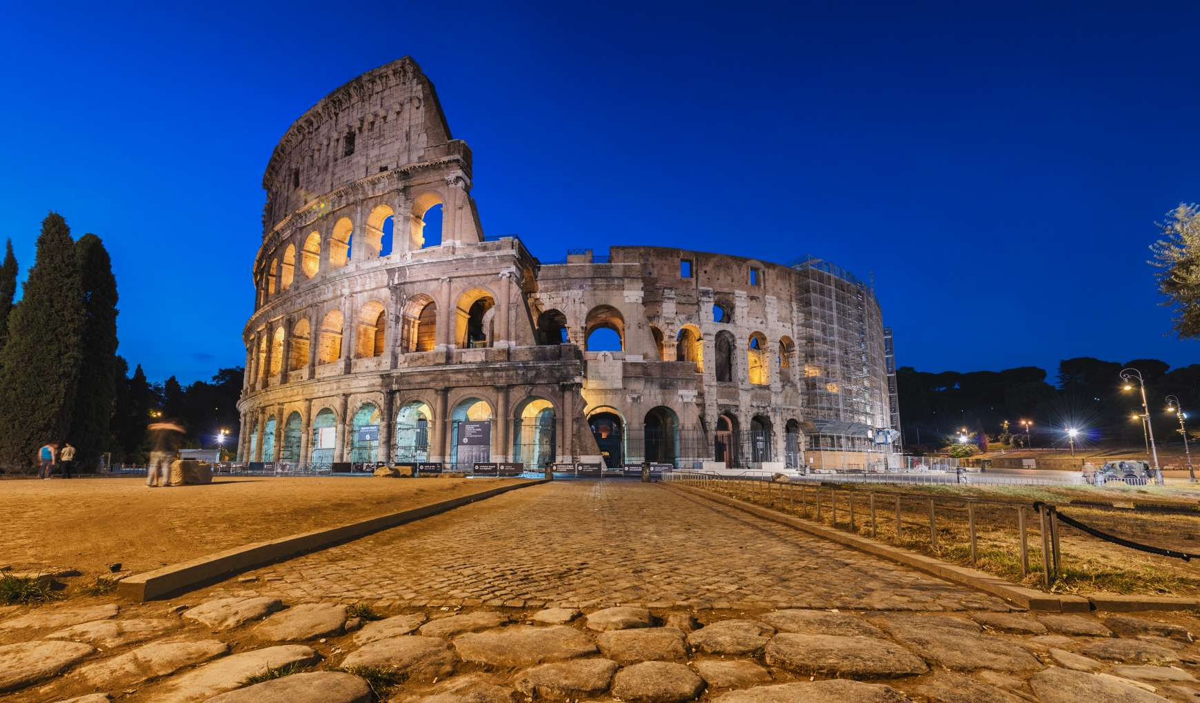 Night view exterior walls of the Colosseum in Rome