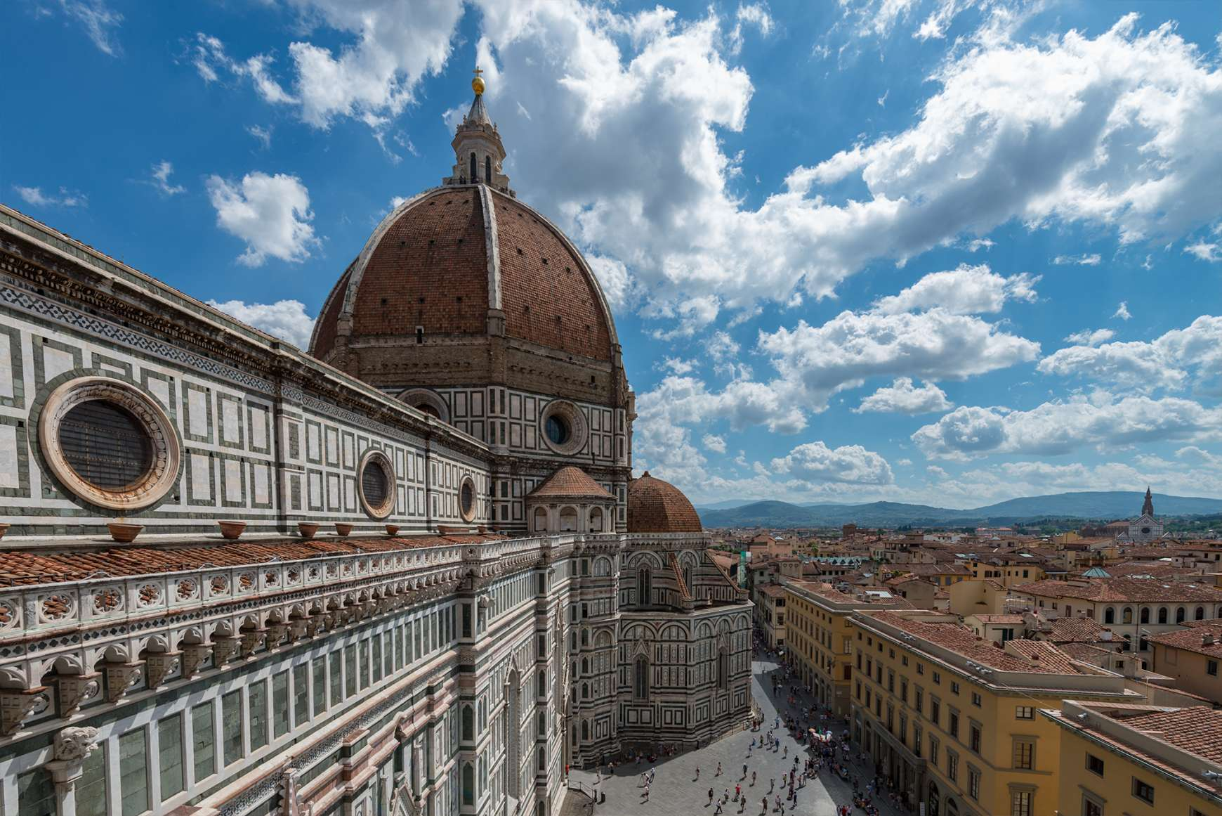 Colorful marble decorating Il Duomo Cathedral with a view of Florence