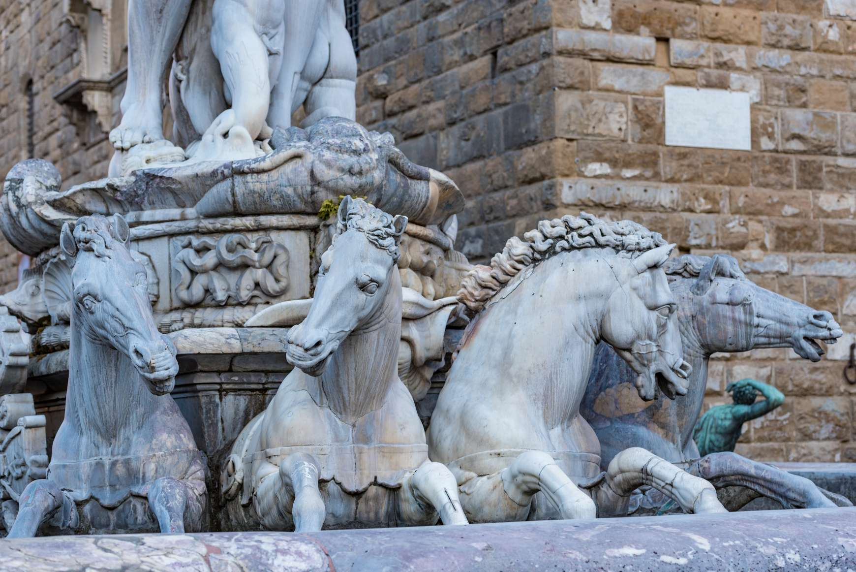 Horses carrying Neptune in fountain at Piazza della Signoria in Florence