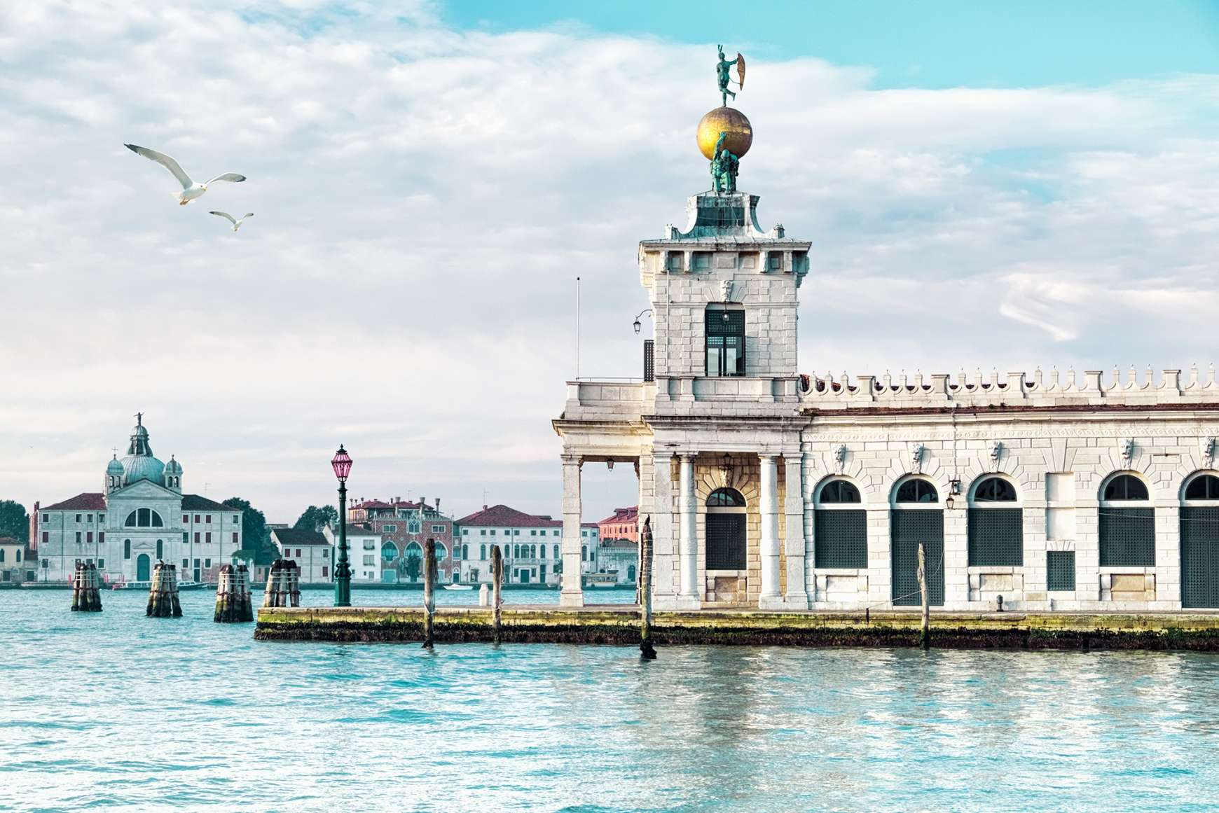 View of Punta della Dogana's art center jutting out into the water in Venice