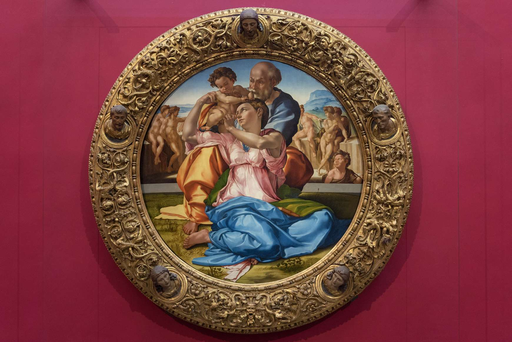 Round framed painting of the Holy Family in the Uffizi Gallery, Florence