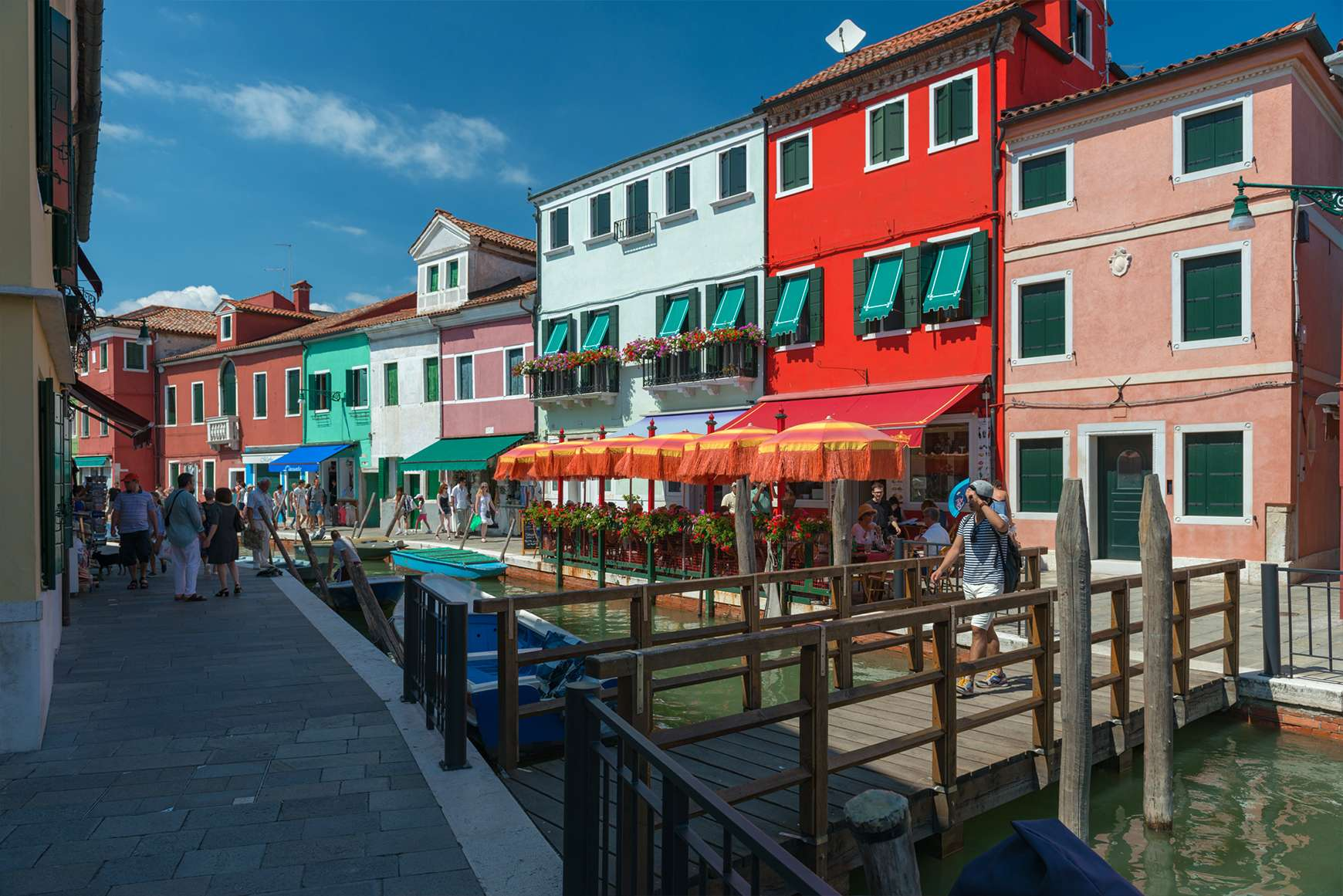 Colorful buildings alongside a canal on the island of Burano in Venice