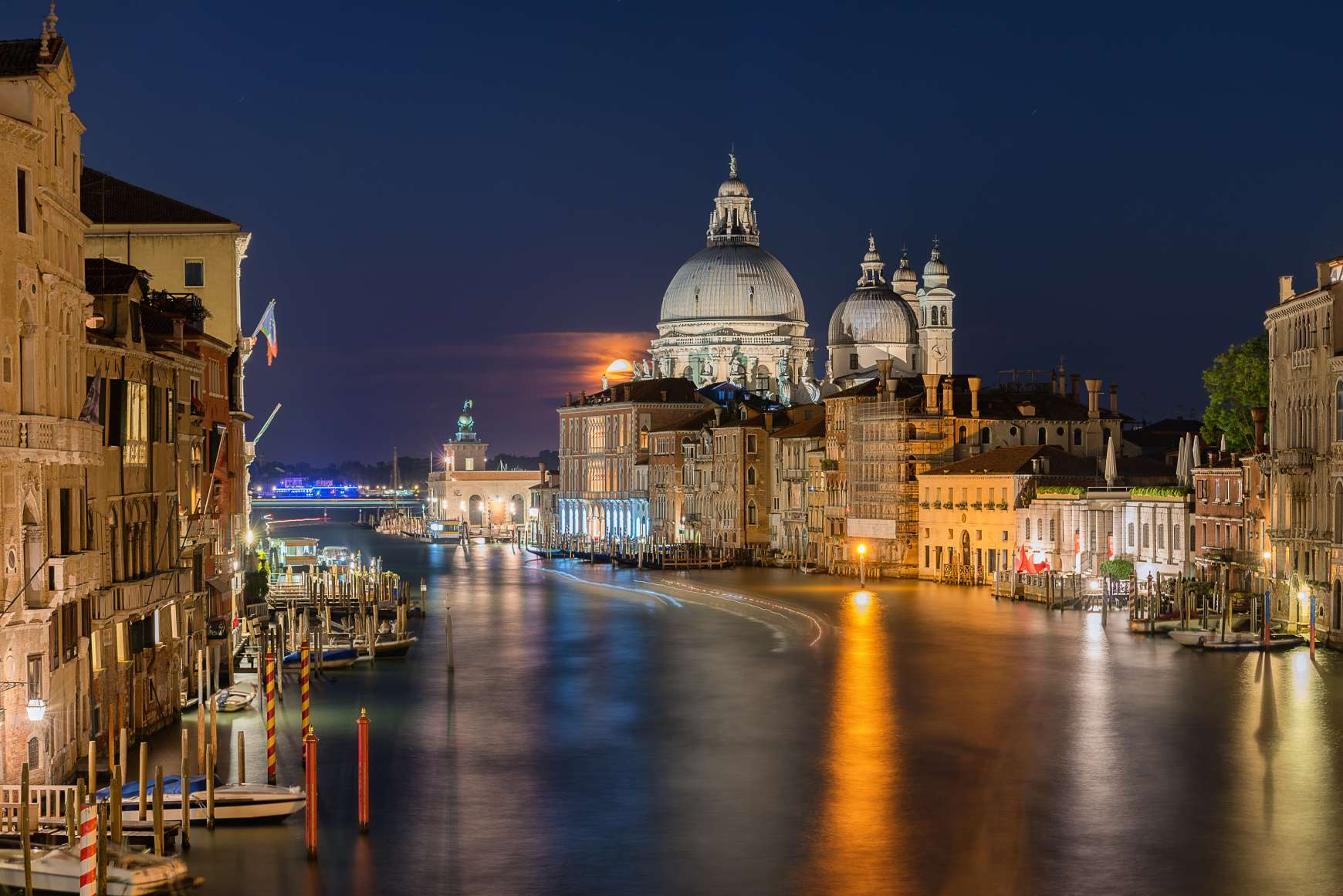 Night lights shining down on the water of the Grand Canal  in Venice