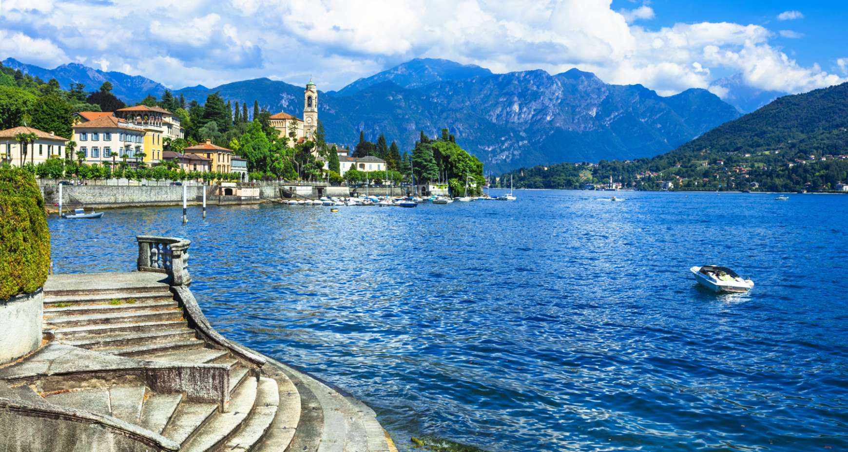 Summer view of Lake Como with mountains in the background