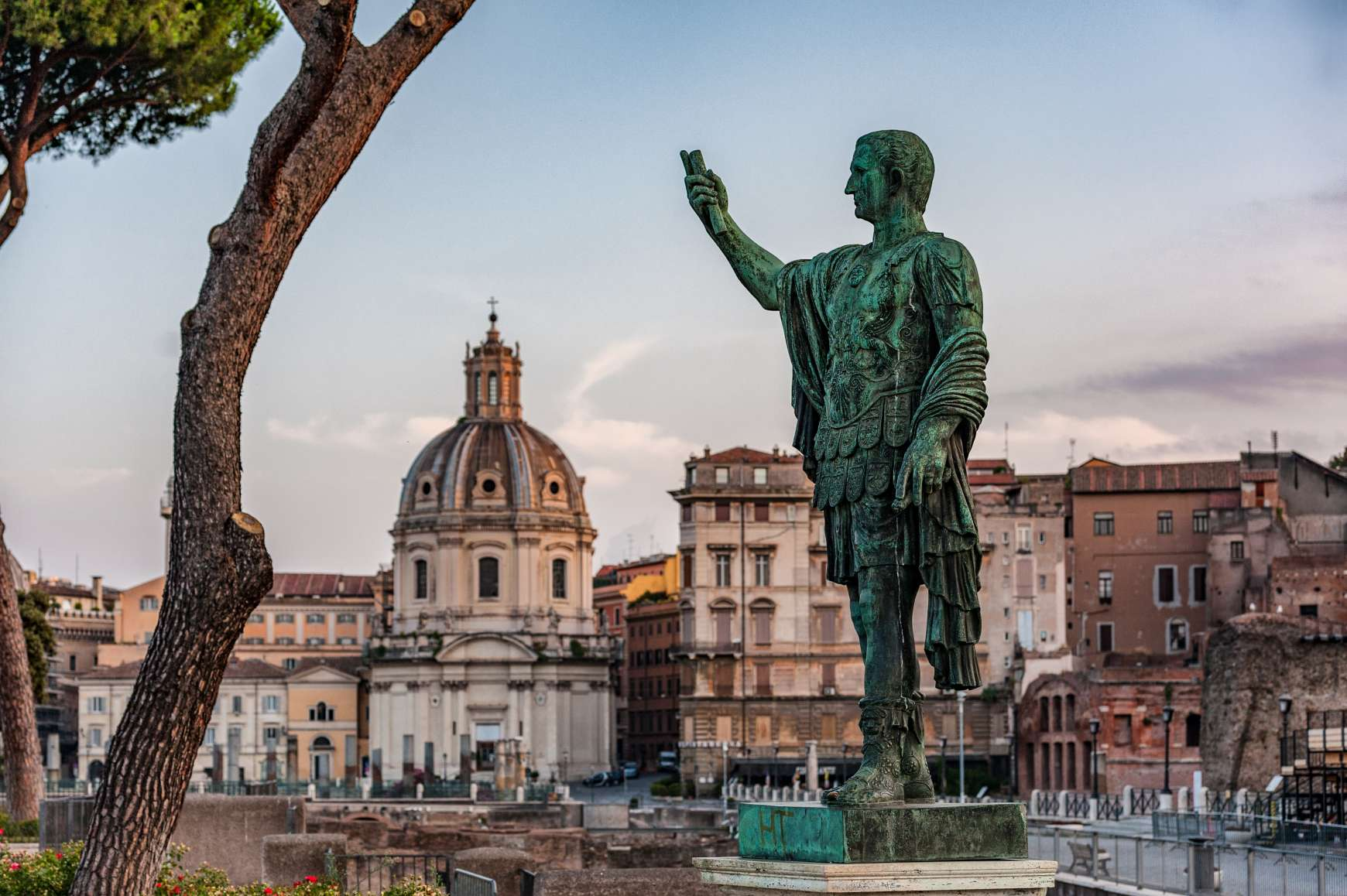 View of statue of Caesar Augustus with Roman Forum in the background