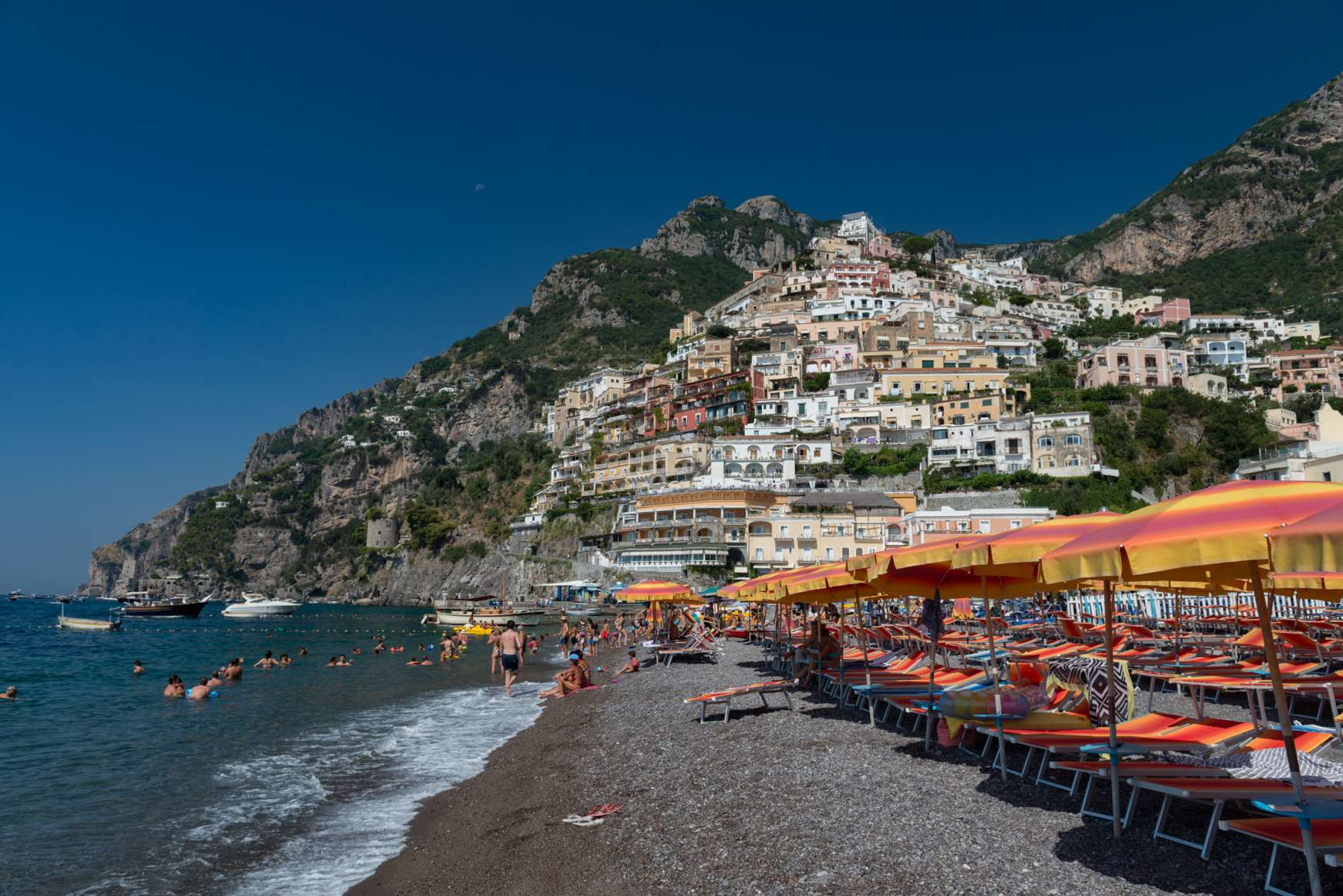 View of black sand beach with Positano rising in the background