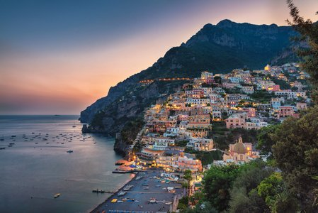 View of Positano nestled against the mountains at sunset, Amalfi Coast