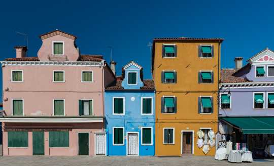 Colorful buildings in a row on the island of Burano, Venice