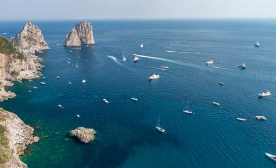 Bird's eye view of Faraglioni cliffs and Tyrrhenian Sea, Capri Island, Italy
