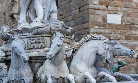 Fountain with horses carrying Neptune at the Piazza della Signoria in Florence