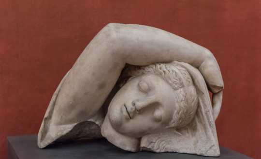 Head and arm detail of sleeping Ariadne at the Uffizi Gallery in Florence