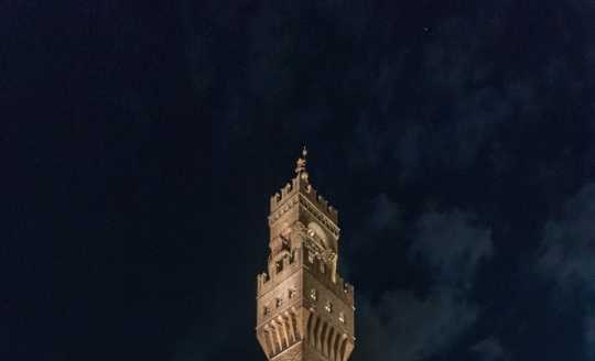 Night view of the ell tower at Piazza della Signoria in Florence