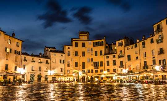 Lights illuminate the Piazza Dell' Anfiteatro in Lucca, Italy
