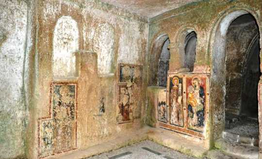 Interior paintings of cave church, Santa Barbara in Matera, Italy