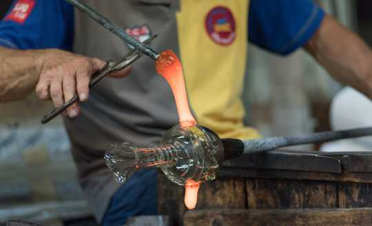 Glass maker bending glass in Murano Italy