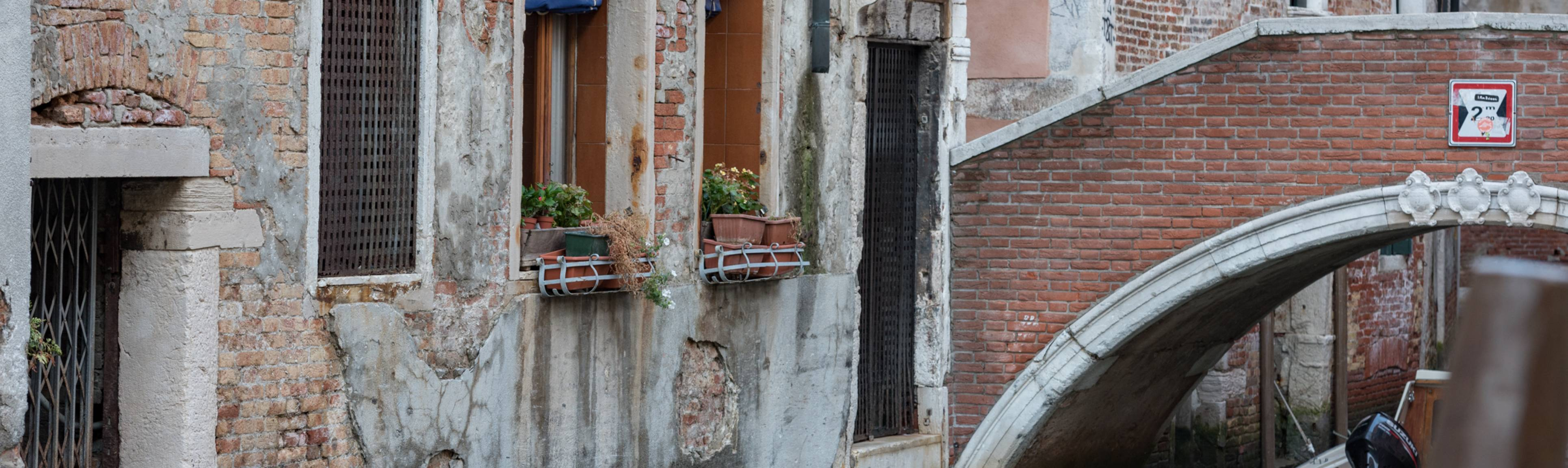 View of bridge & buildings along the small canals in Venice, Italy