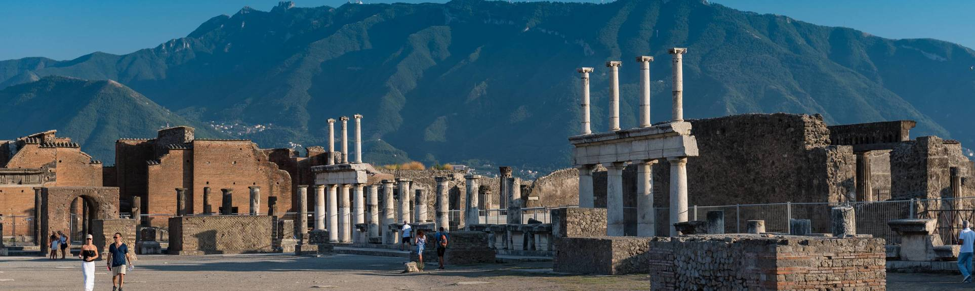 Looking at ruins of Pompeii with Mt. Vesuvius as a backdrop