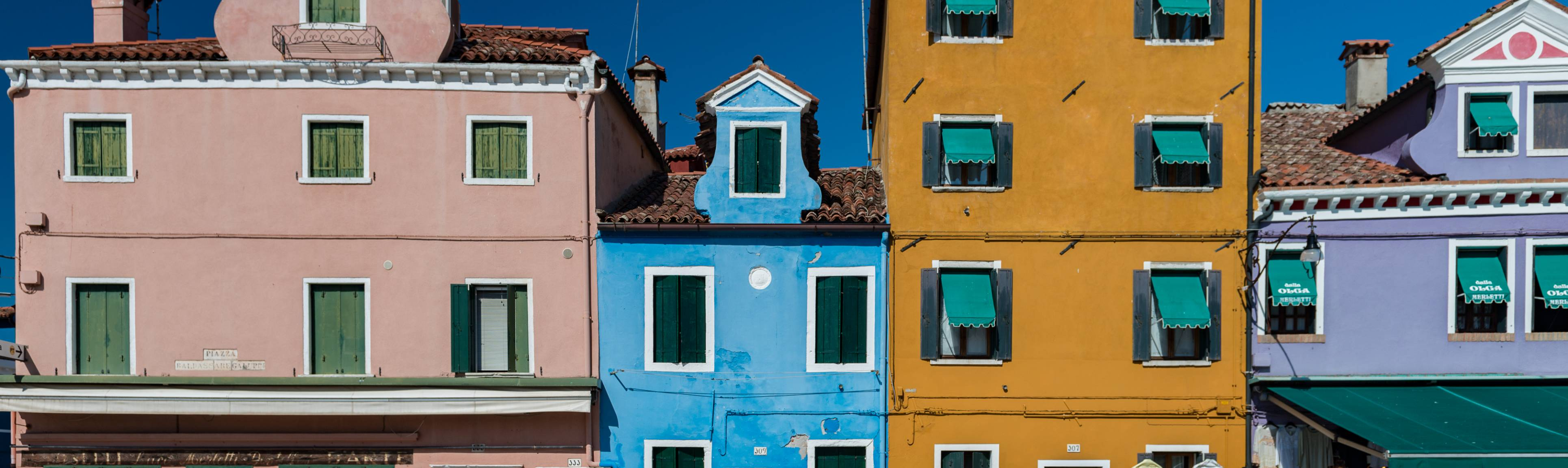 View of colorful buildings in a row on the island of Burano off Venice