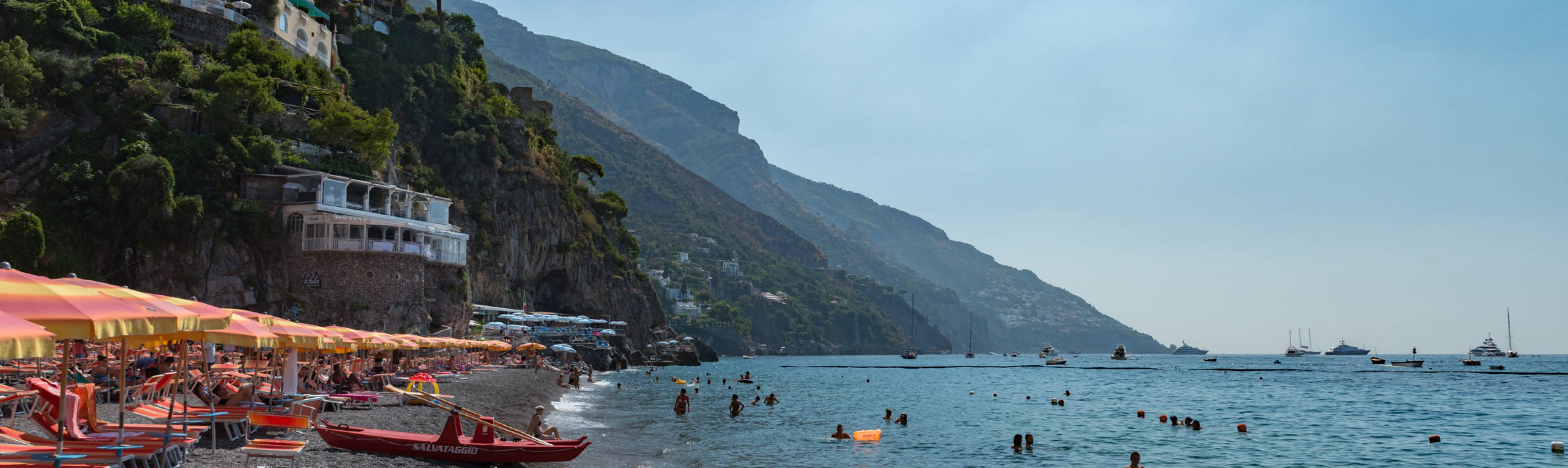 Panoramic view of people bathing in beaches of Amalfi Coast