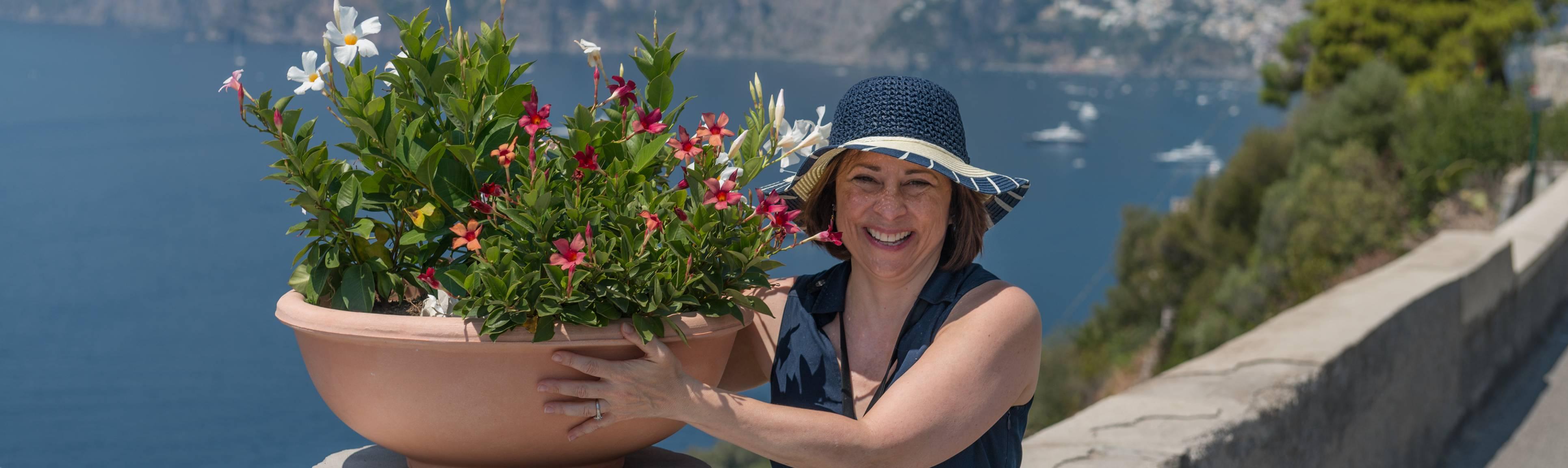 Carmen with urn filled beautiful flowers overlooking the Amalfi Coast