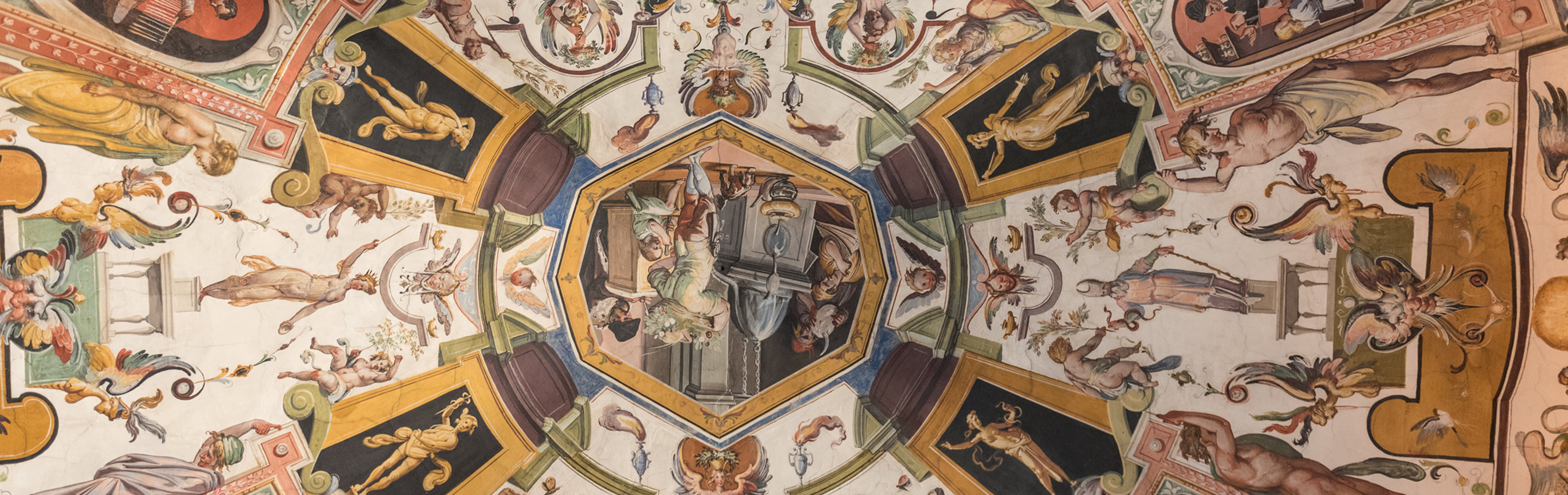 Looking up at the paintings on the ceiling of Florence's Uffizi Gallery