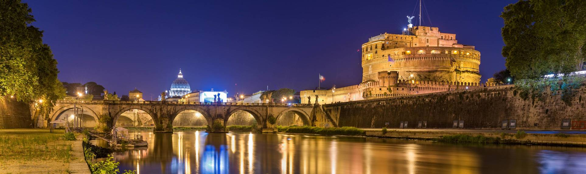 Illuminated night view of Angel Bridge and Castel Sant'Angelo in Rome