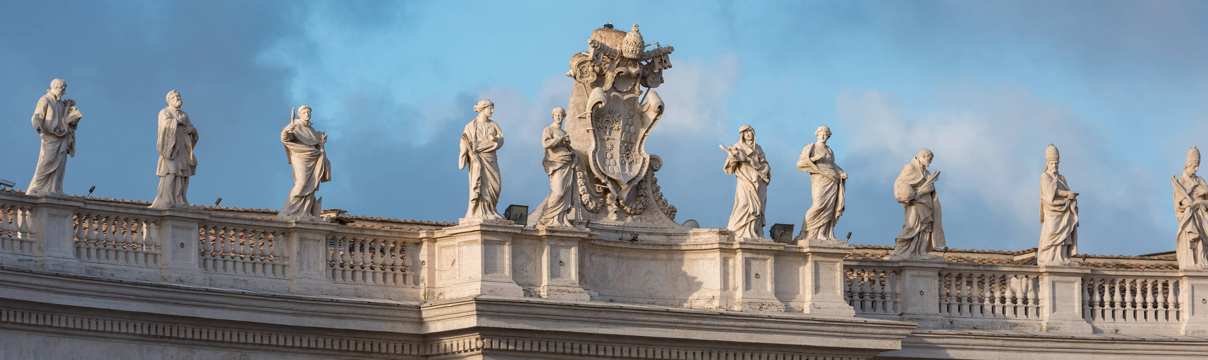 Statues atop entrance to colonnade of St. Peter's Basilica, Rome