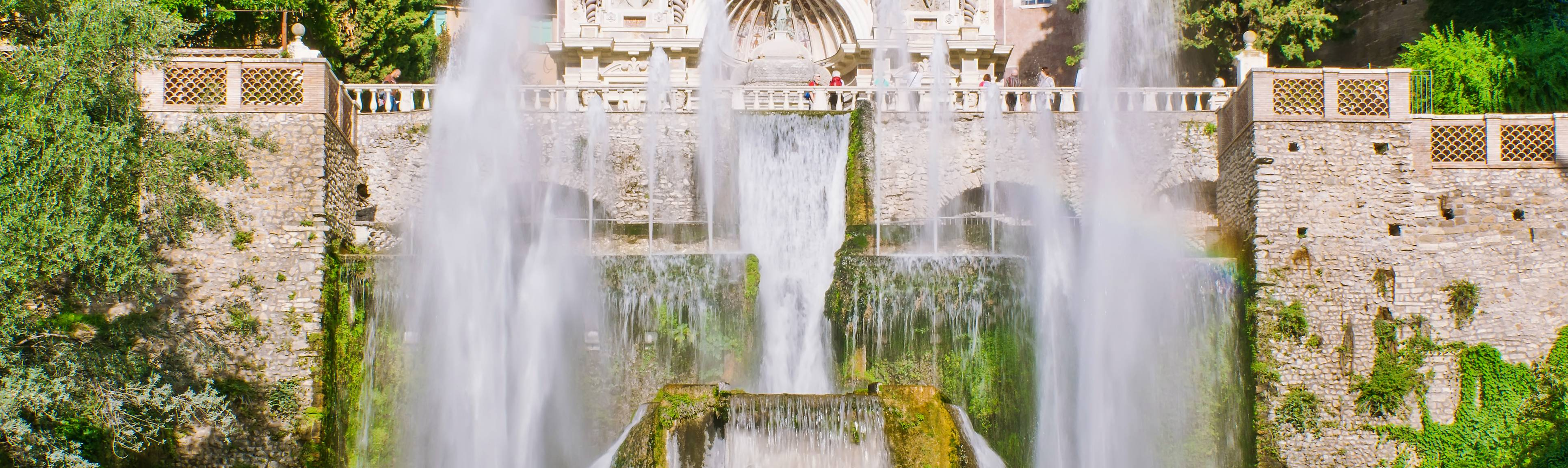 Two fountains with Villa D'Este in the background in Tivoli
