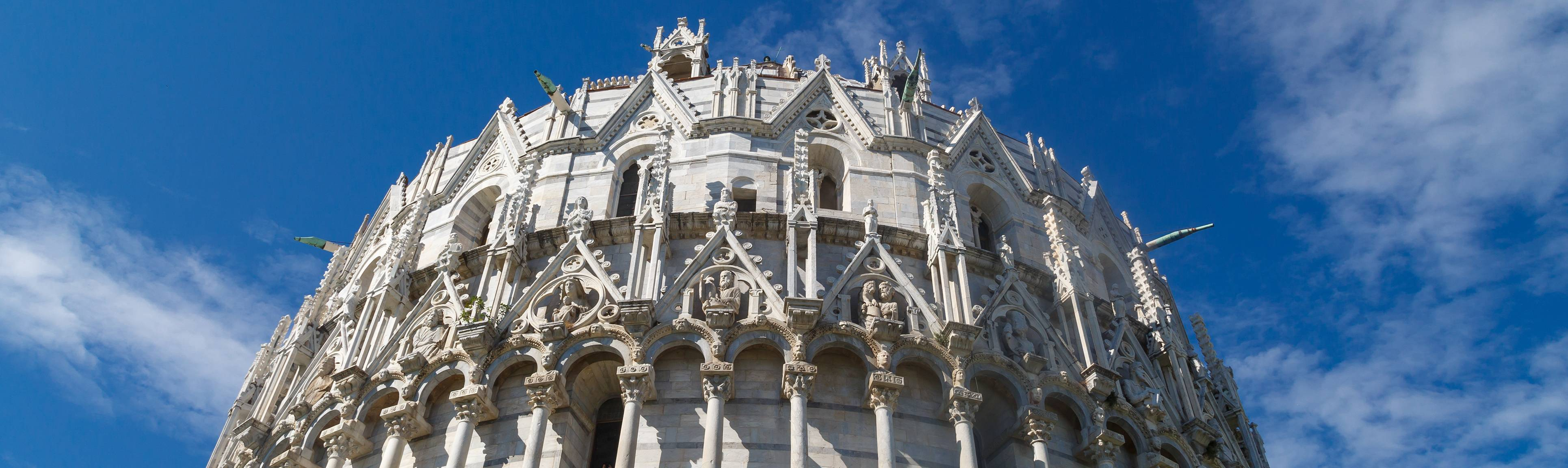 View of ornate exterior of the Baptistry in Pisa, Italy