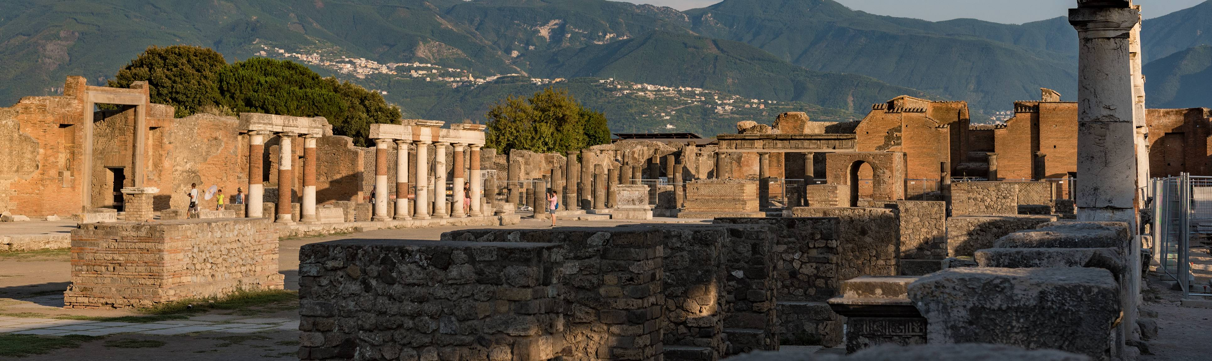 Ruins of buildings at Pompeii with Mt. Vesuvius in the background