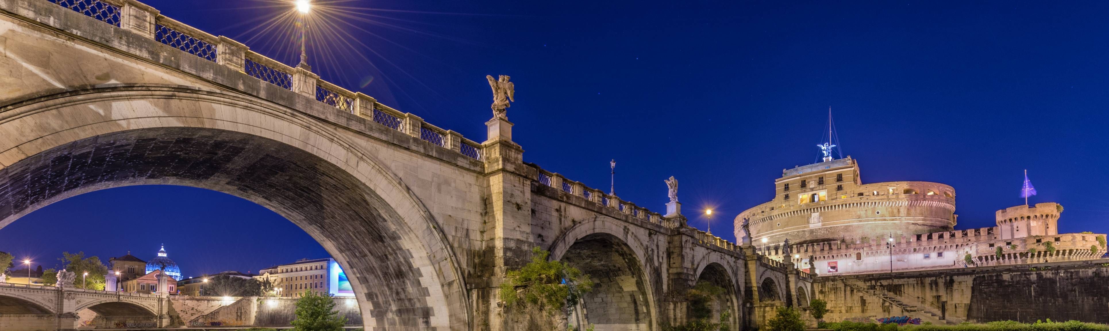 Evening view of Angel Bridge and Castel Sant'Angelo in Rome