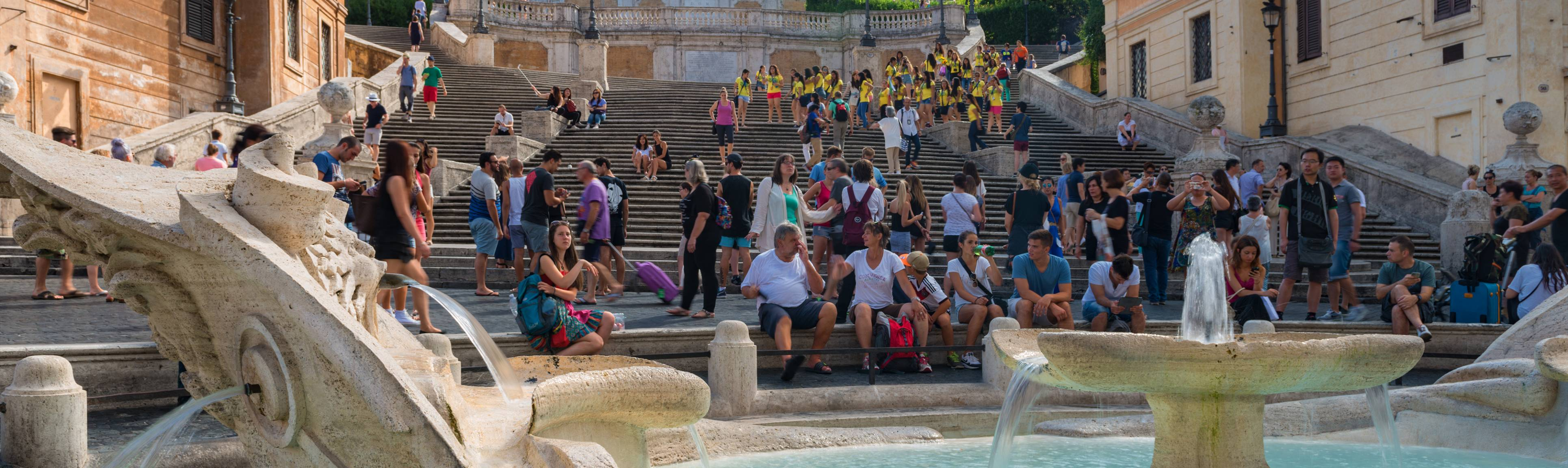 Close up of visitors sitting on the Spanish Steps in Rome
