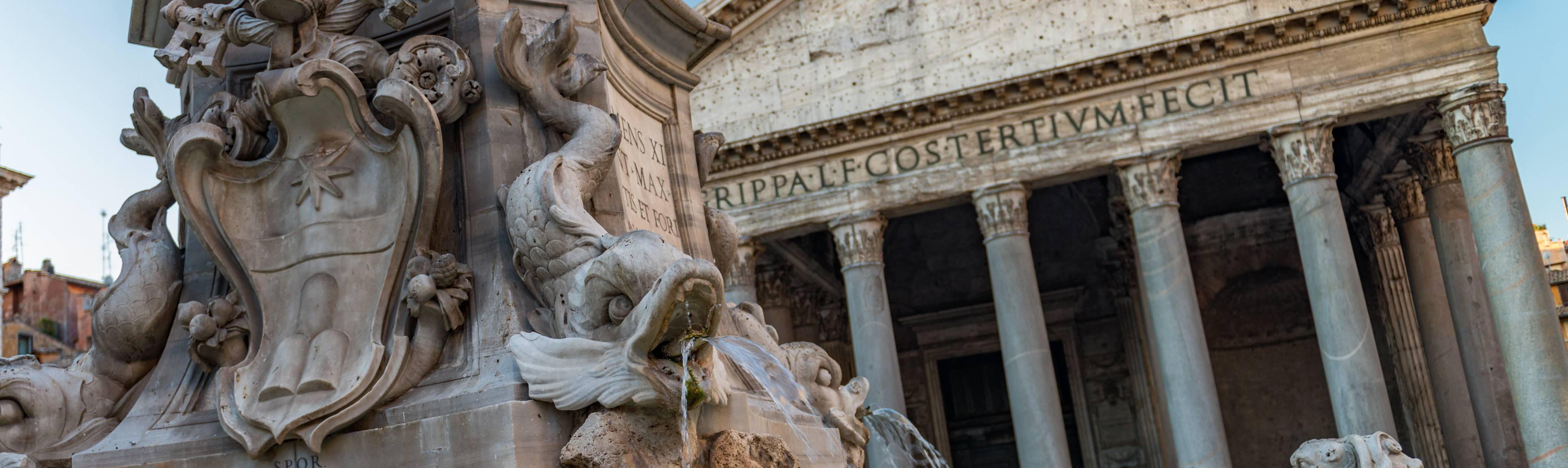 Detail of fountain and front colonnade of Pantheon in Rome