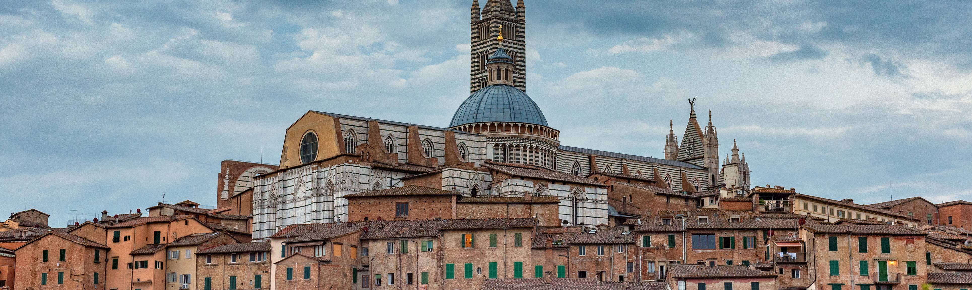 Looking over the skyline and rooftops of Siena, Italy
