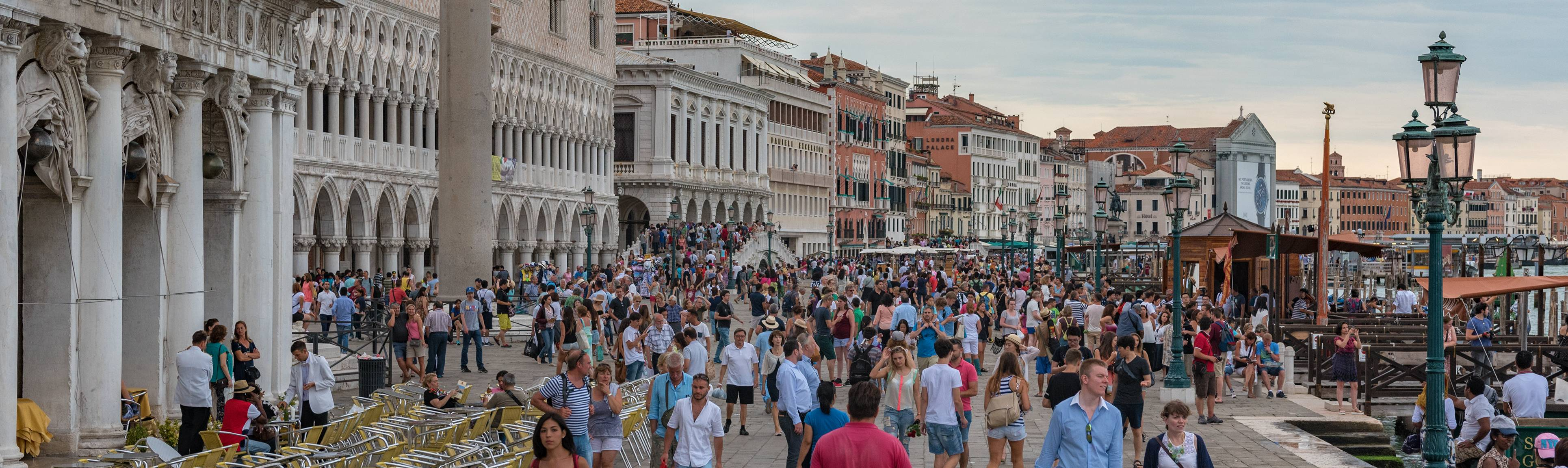 Many visitors walking through the Piazza San Marco in Venice