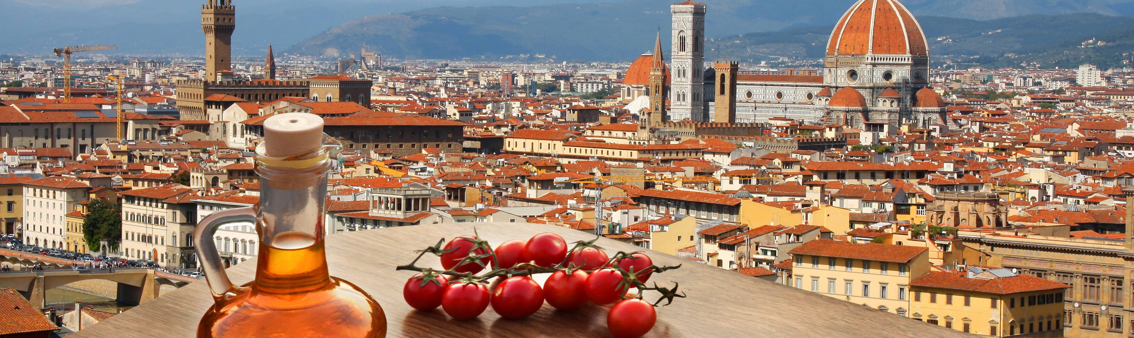 Tomatoes & olive oil on a table overlooking the rooftops of Florence