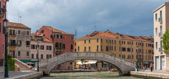 Looking at Ponte degli Scalzi and Venetian buildings