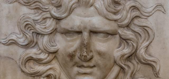Detail of face on plaster decoration at Roman Villa