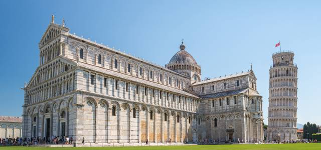 Exterior view of the Pisa Cathedral with the Leaning Tower to its right