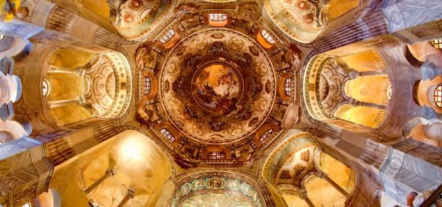 Looking up at mosaics of the octagonal interior of Basilica San Vitale