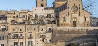 View of Cathedral Santa Maria della Bruna rising majestically over Matera's highest point