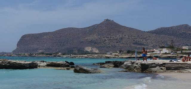 View of rocks with mountain backdrop at Favignana Beach, Sicly