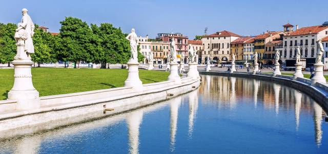 Statutes line the border of Prato della Valle in Padua, Italy