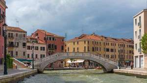 Looking at Ponte degli Scalzi and Venetian buildings