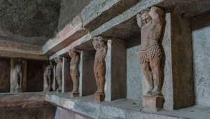 Statues lining the walls of a home in Pompeii