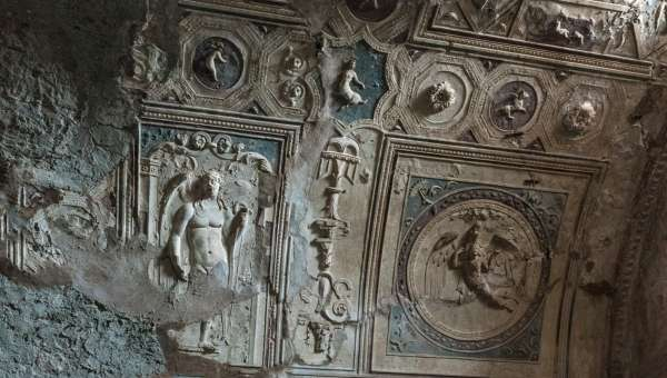 Plaster figures decorating walls at ruins of Pompeii, Italy