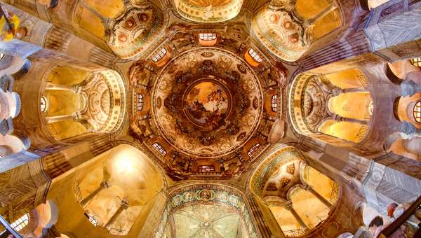 Looking up at mosaics of the octagonal interior of Basilica San Vitale