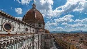 Colorful marble facade and dome of the Cathedral in Florence, Italy